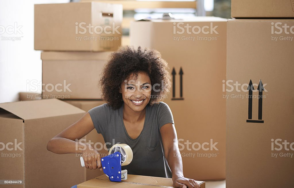 Packing is hard work but she can cope royalty-free stock photo