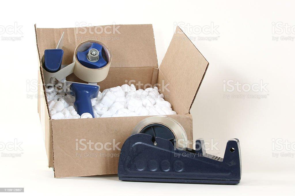 Packing materials tape, cardboard box peanuts dispenser royalty-free stock photo