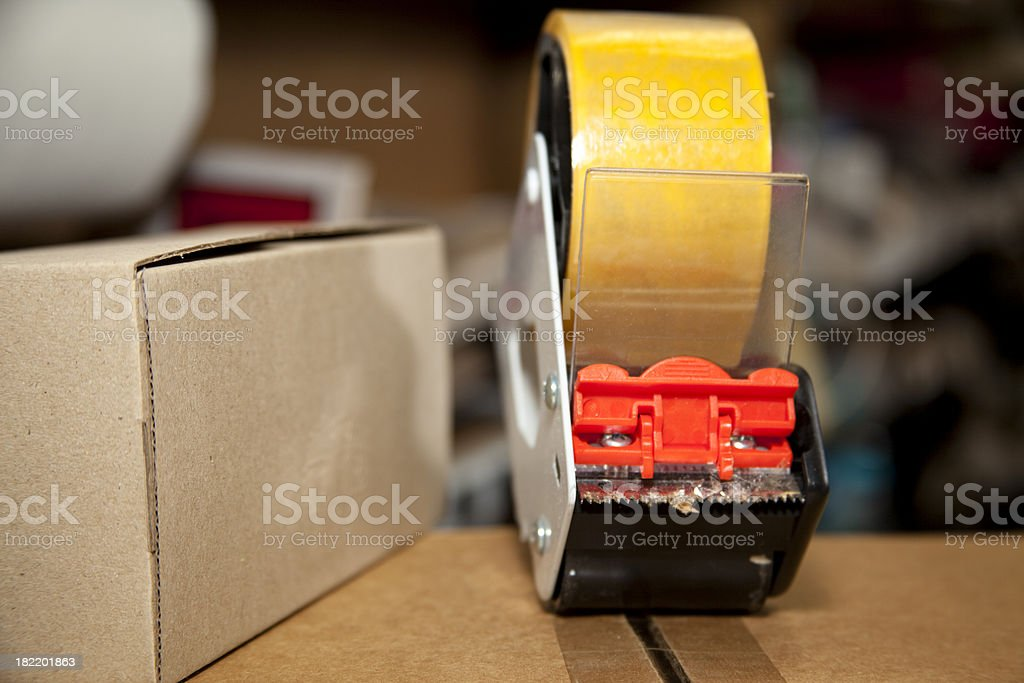 Packing materials tape, dispenser cardboard box royalty-free stock photo