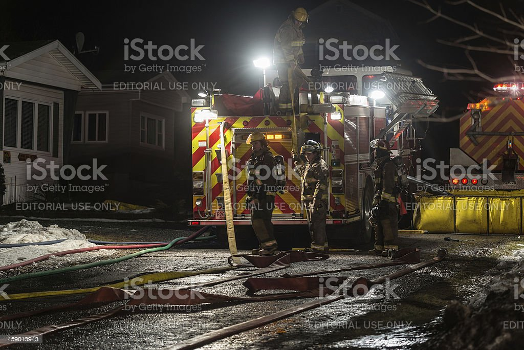 Packing up Fire Hoses stock photo