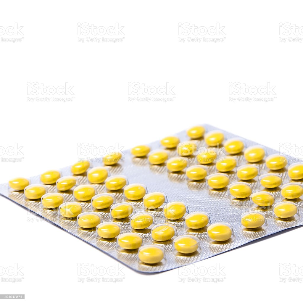 Packings of pills and capsules medicines stock photo