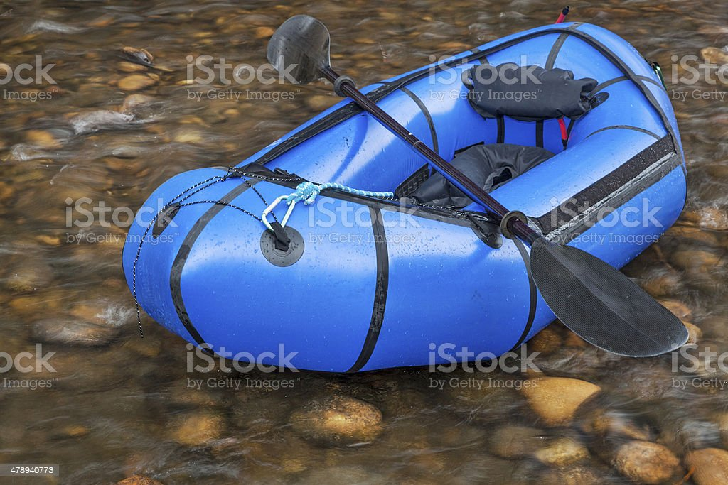 packraft with a paddle stock photo