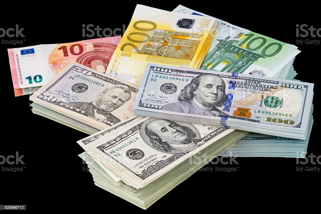 Packs of dollars and euros on a black stock photo
