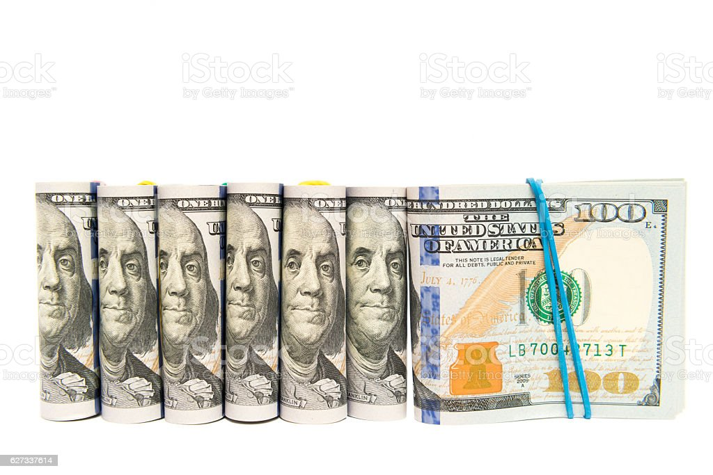 Packs of hundred dollar bills grouped, isolated copyspace stock photo