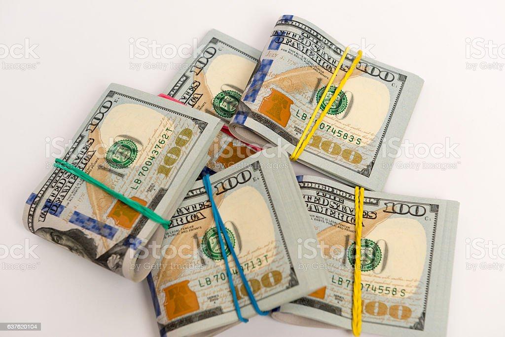 Packs of hundred dollar bills stock photo