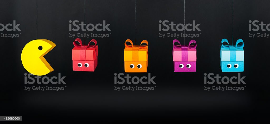Pac-Man and gift boxes stock photo