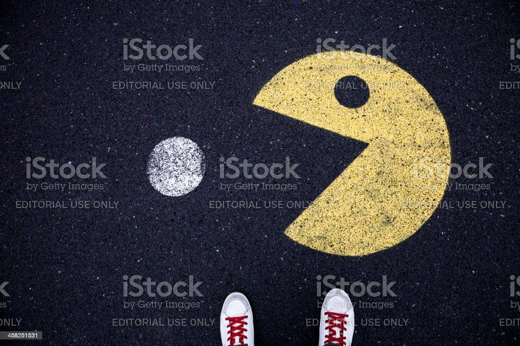 Pacman character drawn on asphalt royalty-free stock photo