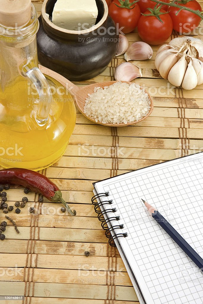 pad, garlic and tomato with pencil royalty-free stock photo