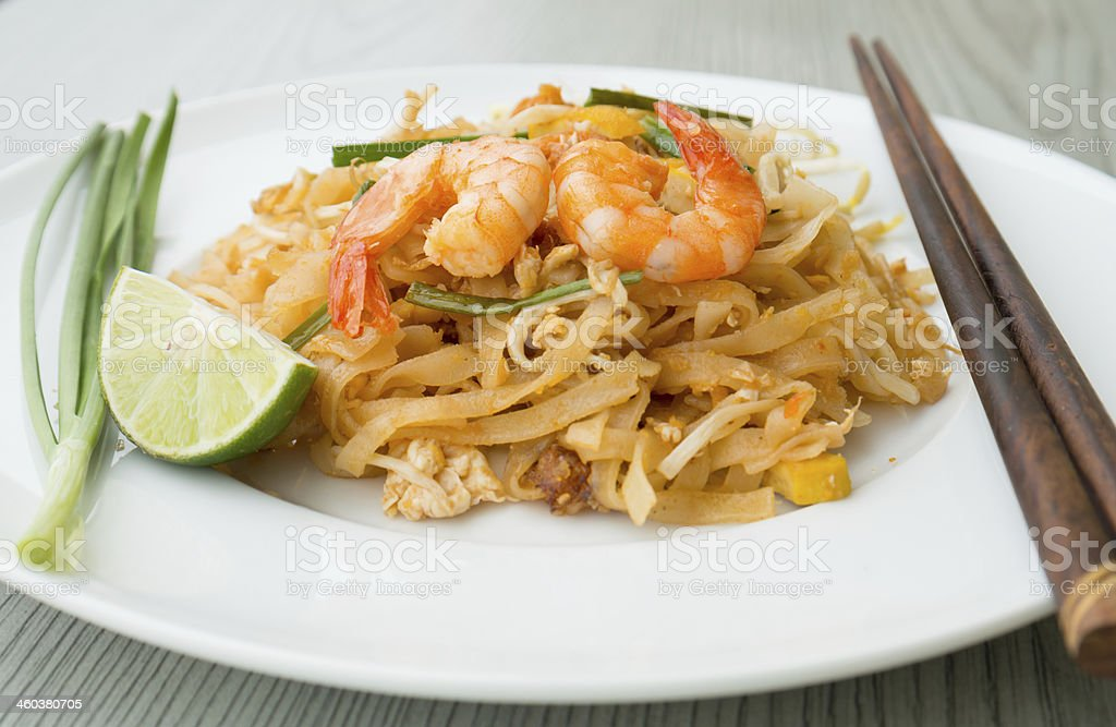 Pad Thai, stir-fried rice noodles with shrimps stock photo