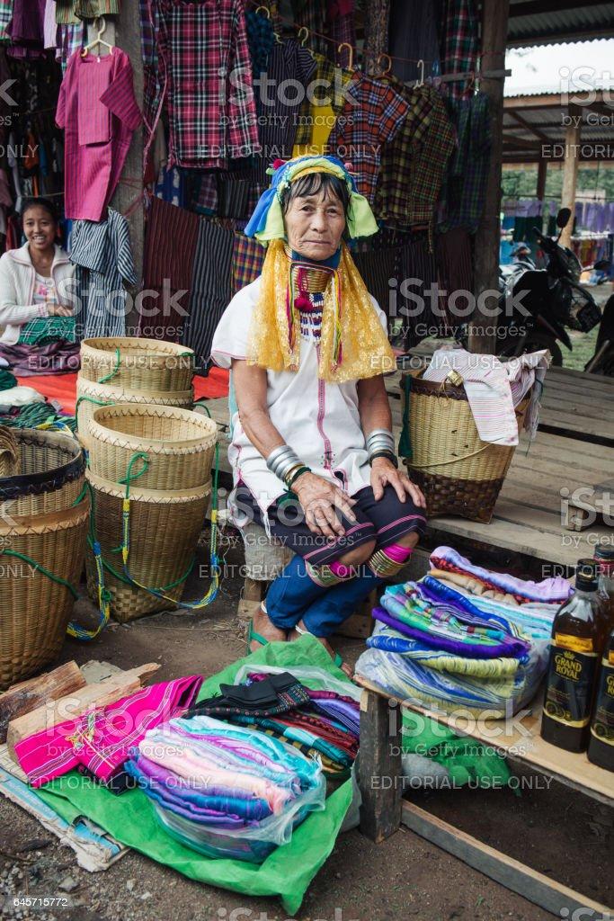 Padaung (Karen) long neck woman selling good stock photo