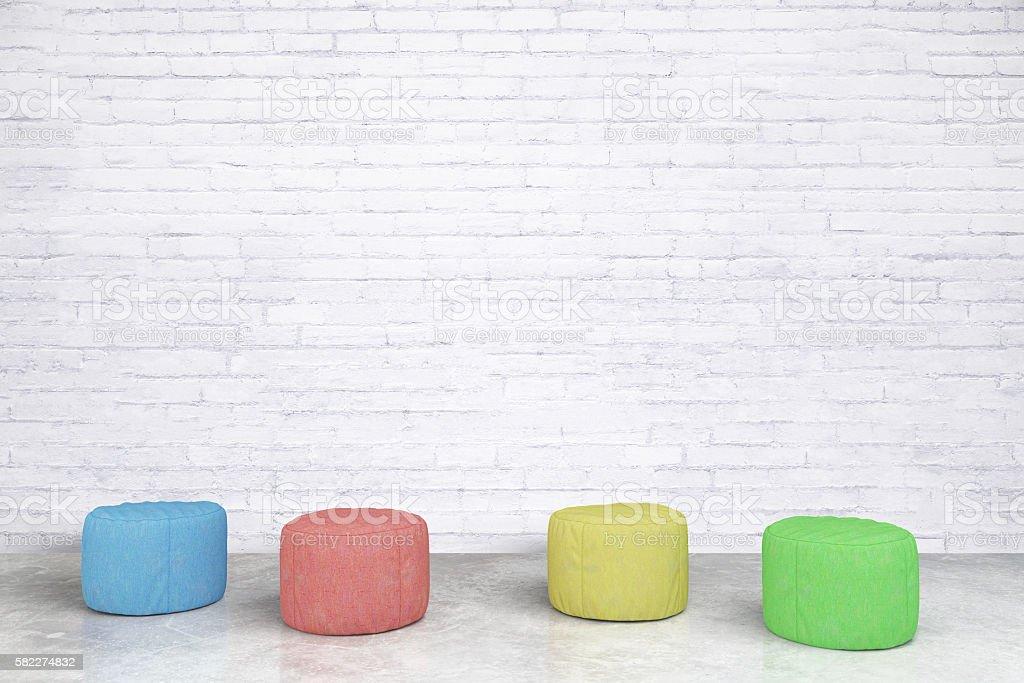 Padded stools in brick room stock photo