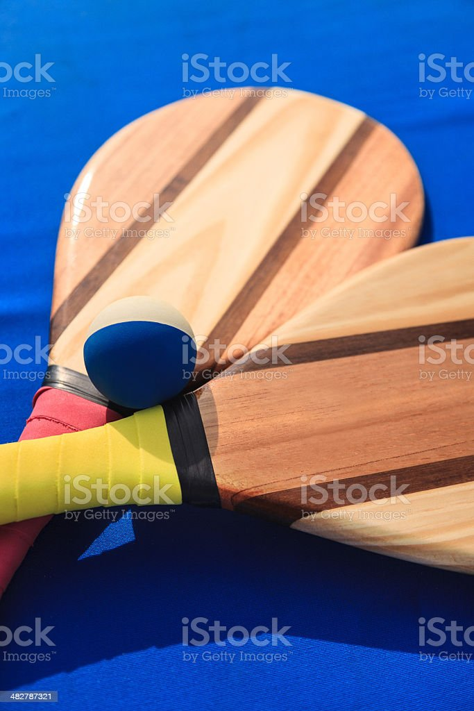 Paddle Ball on the Beach stock photo