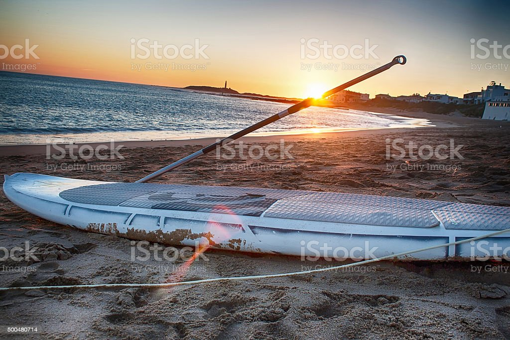 Paddle board at sunset stock photo