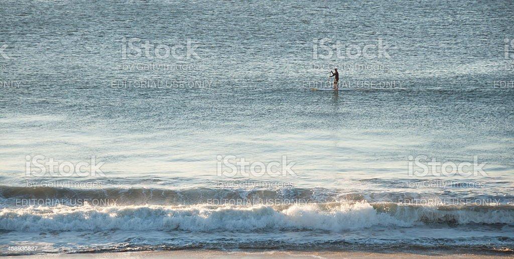 Paddle Boarder at Sunrise stock photo