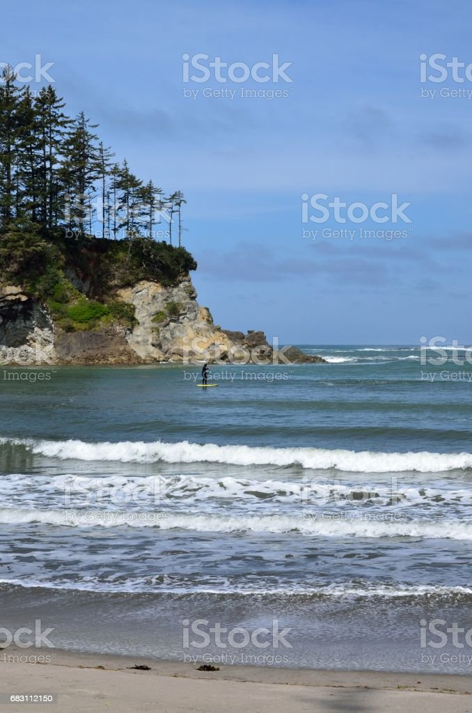 Paddle Boarder In Sunset Bay State Park, Oregon stock photo