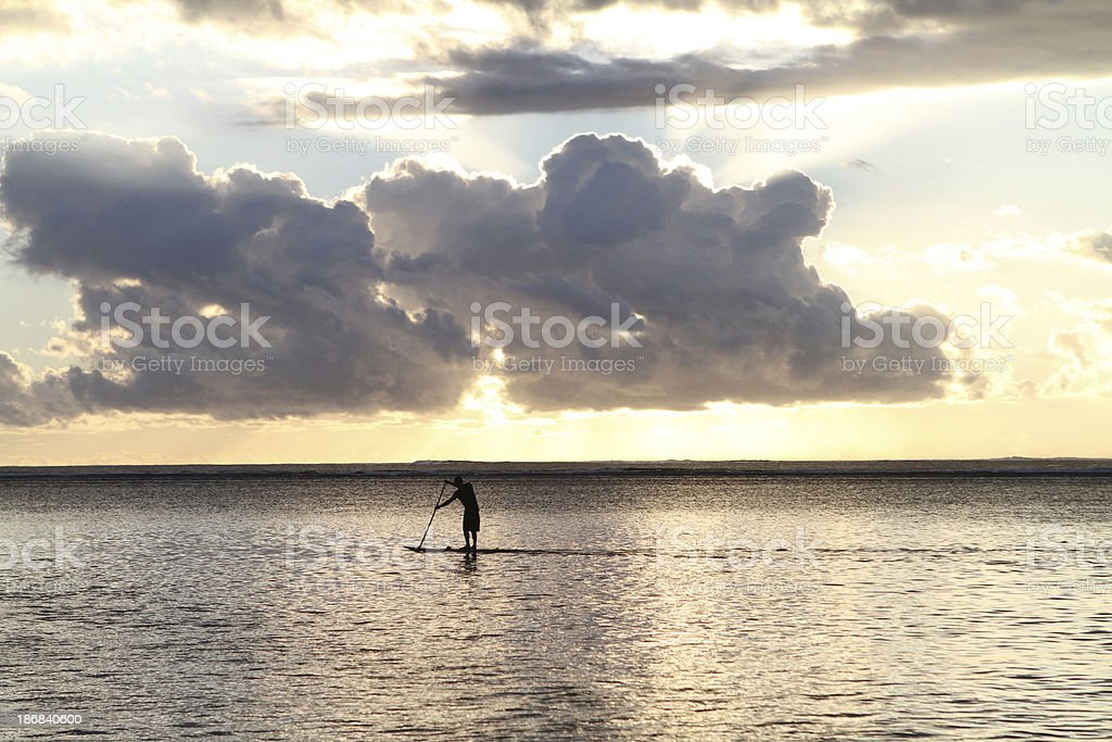 paddle boarding at sunset in the south pacific royalty-free stock photo