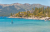 Paddle Boater towing Intertuber Lake Tahoe Sand Harbor