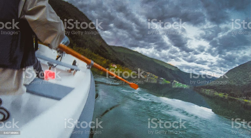 Paddle faster before weather gets us stock photo