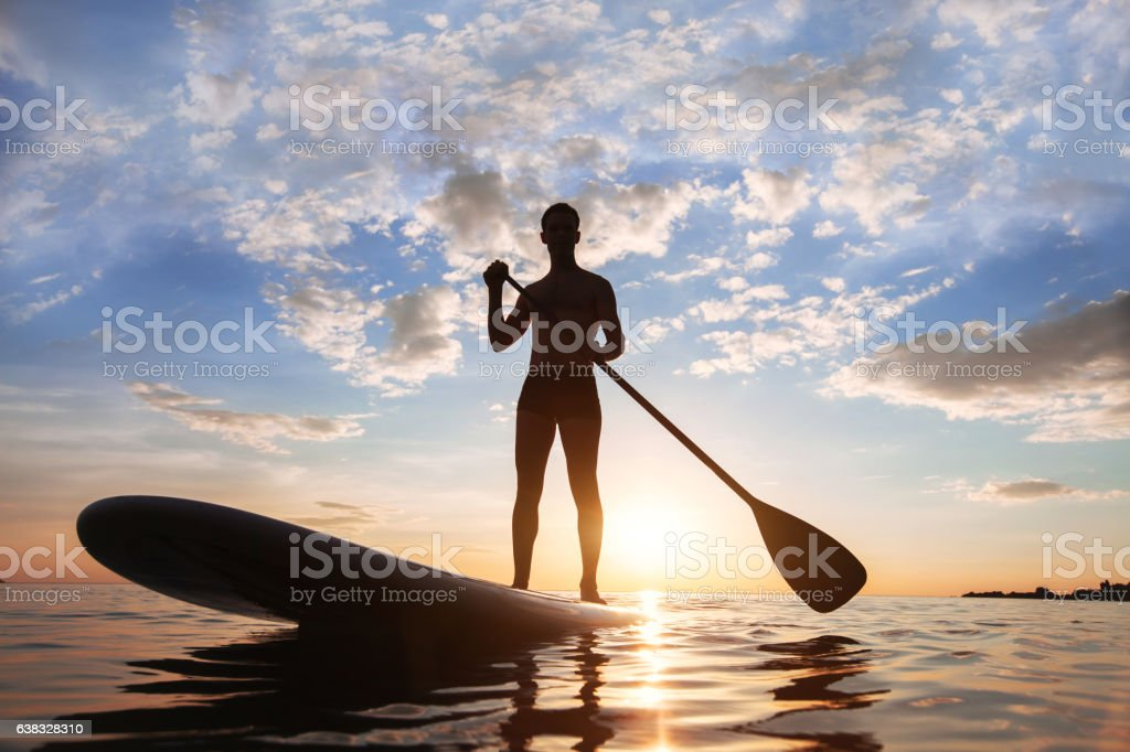 paddle standing stock photo