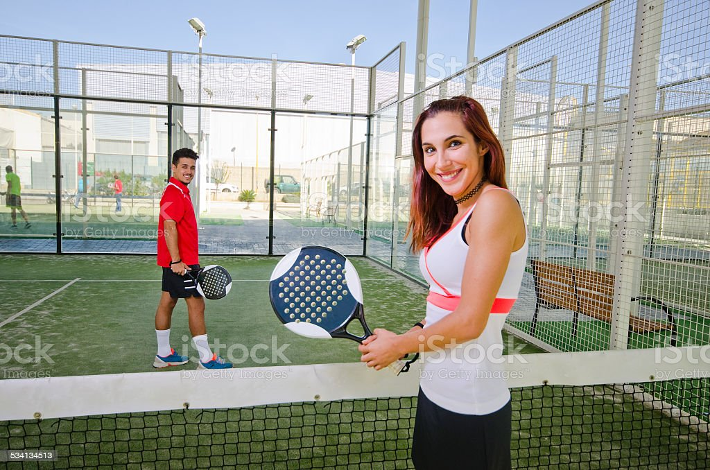 Paddle tennis couple in court stock photo