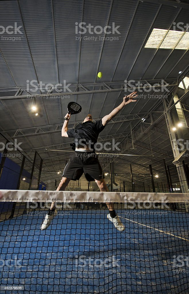 A paddle tennis player in action stock photo