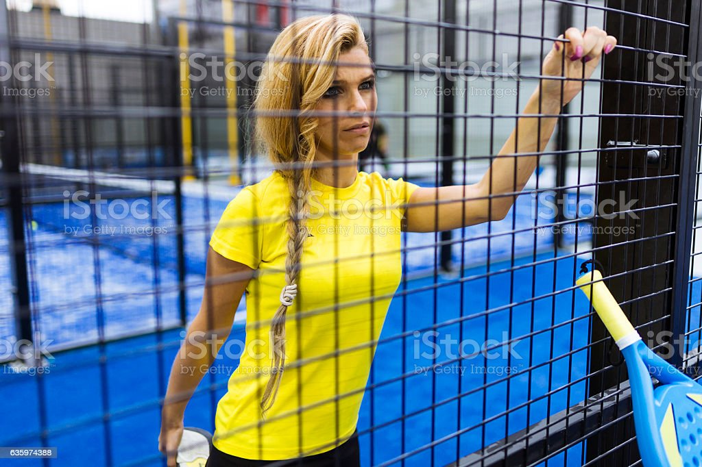 Paddle tennis player preparing for match. stock photo