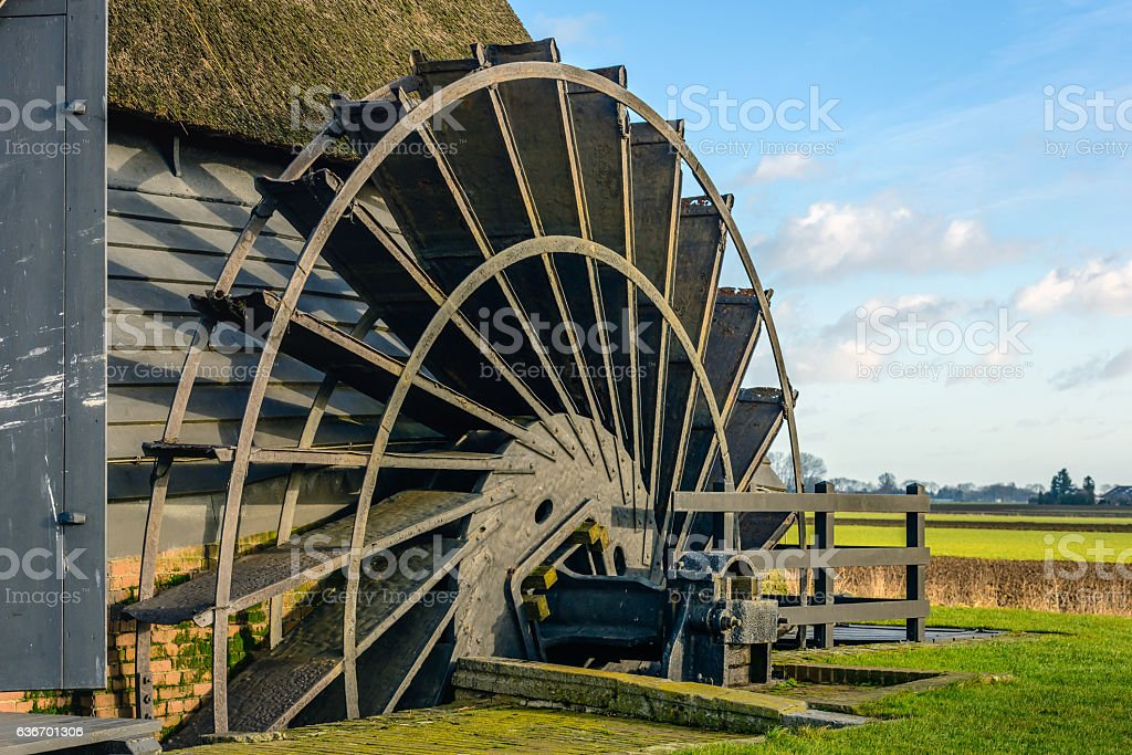 Paddle wheel of an ancient hollow post mill from close stock photo