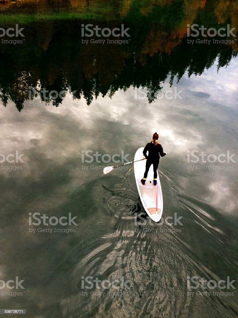 Paddleboard in the Clouds stock photo