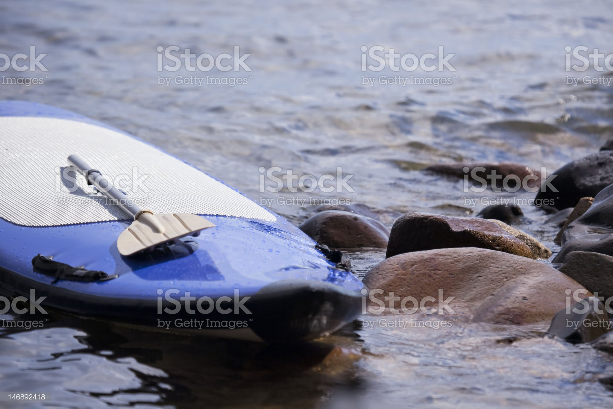 Paddleboard Rocks royalty-free stock photo