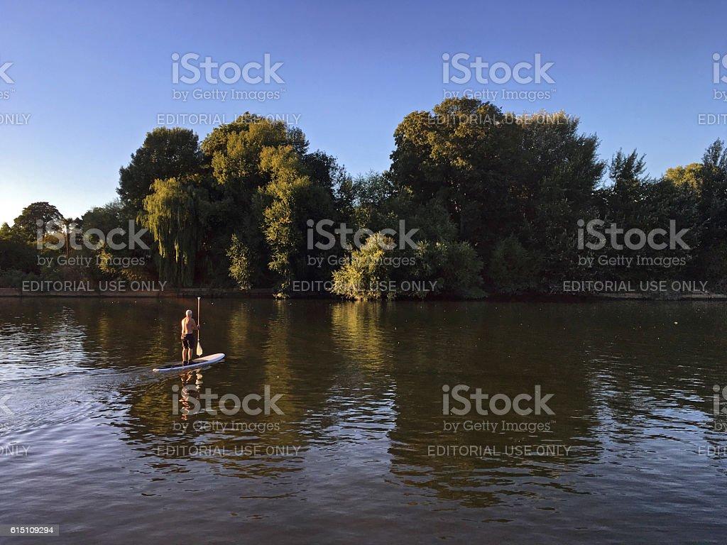 Paddleboarding on River Thames near Richmond, UK stock photo