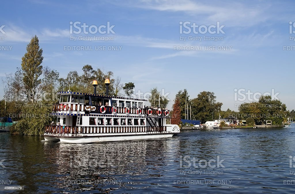 Paddleboat on the River Bure at Horning, Norfolk stock photo