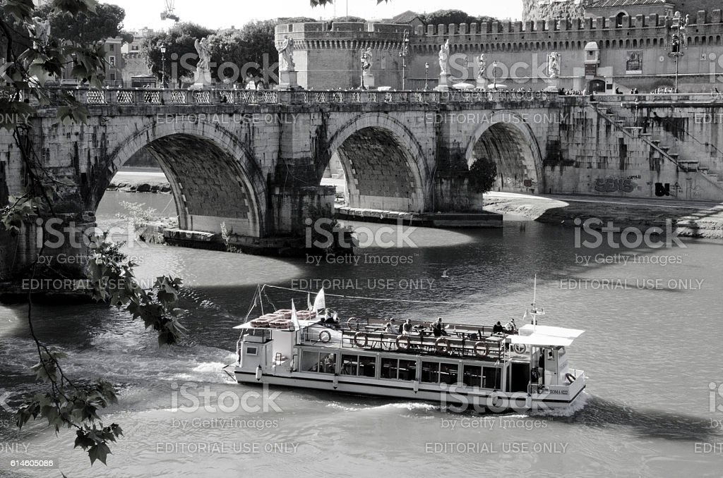 Paddleboat Passes Under the Bridge of Angels in Rome, Ital stock photo