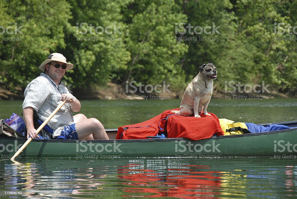 Paddler and a Pooch royalty-free stock photo