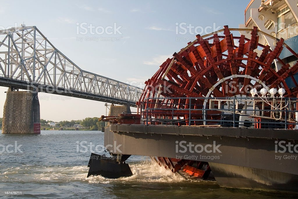 Paddlewheel of a boat about to go under the bridge stock photo