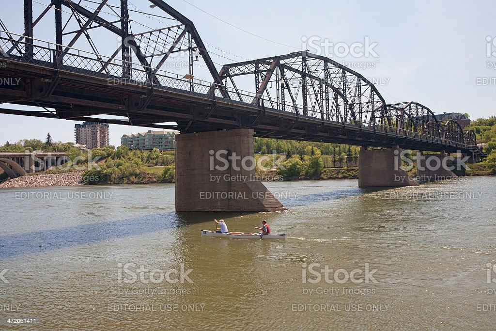 Paddling a Canoe on South Saskatchwan River in Downtown Saskatoon stock photo