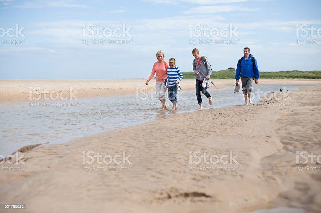 Paddling at the beach stock photo