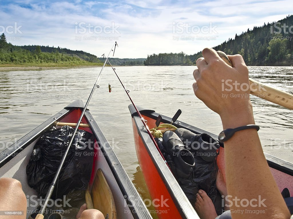 paddling canoes fishing rods canada royalty-free stock photo