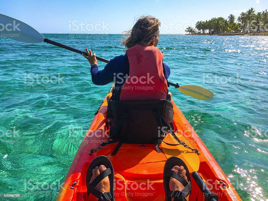 Paddling in atoll stock photo