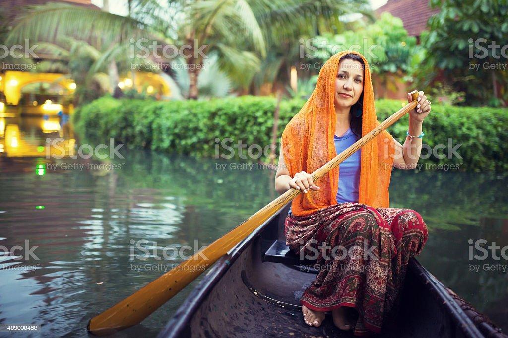 Paddling in India stock photo