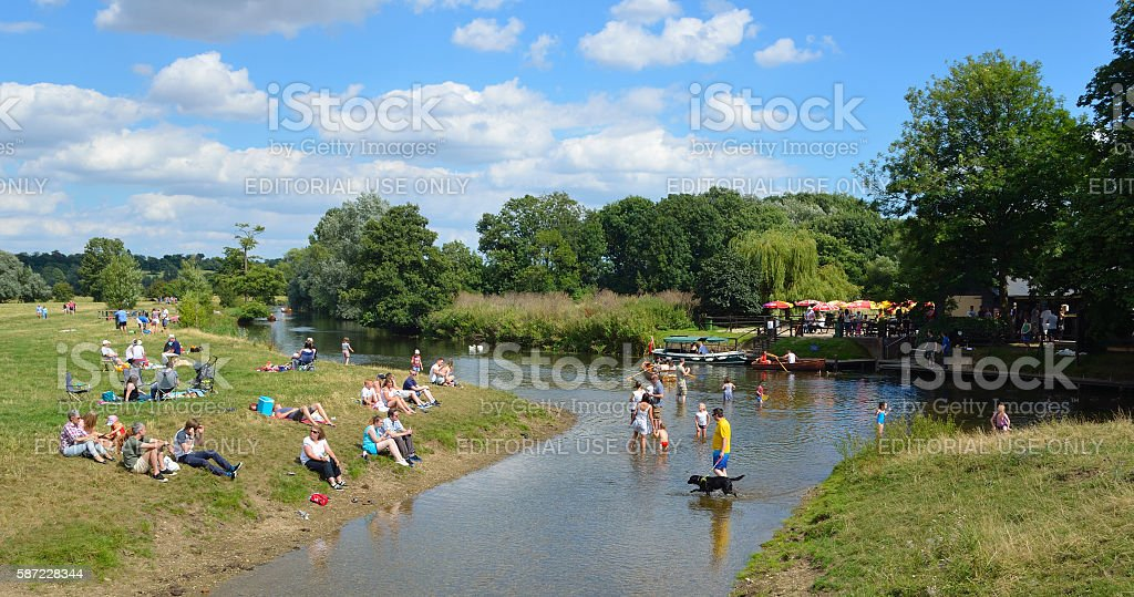 Paddling in the river Stour stock photo