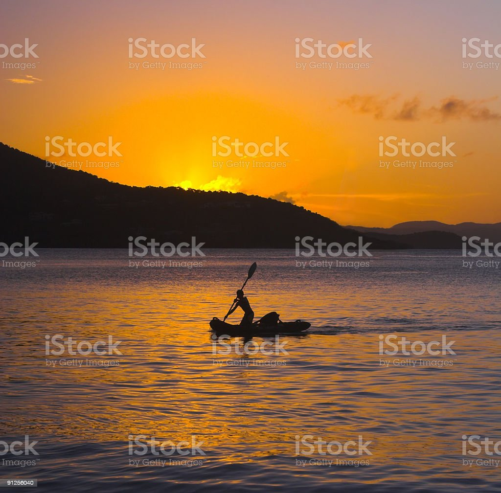 Paddling into Sunset stock photo
