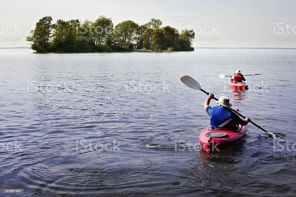 Paddling on a lake stock photo