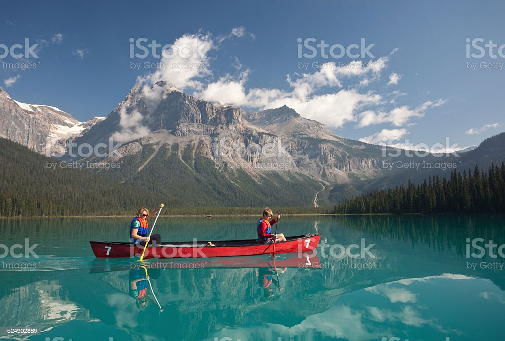 Paddling on Mountain Lake stock photo