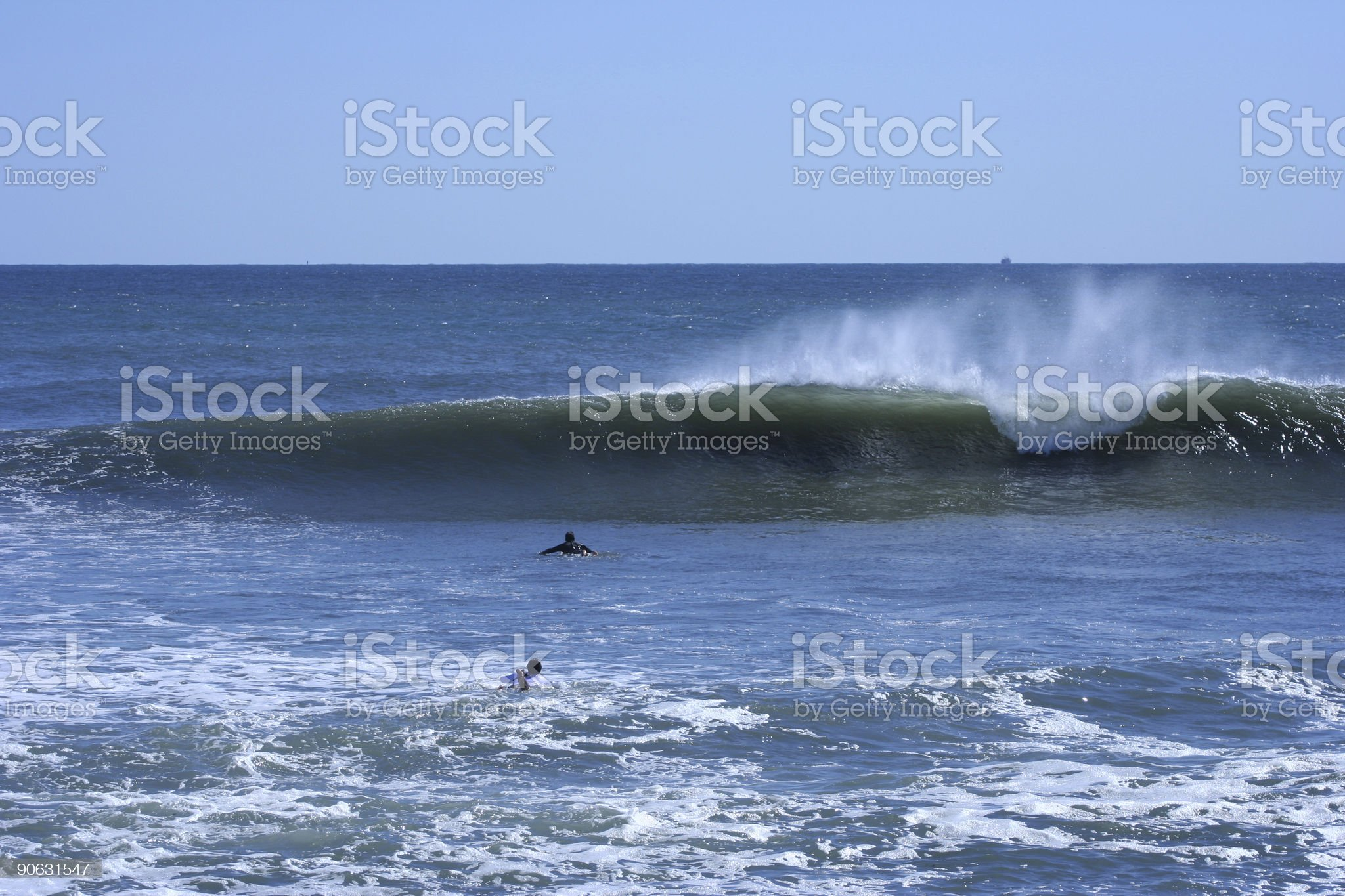 Paddling Out Into the Surf royalty-free stock photo