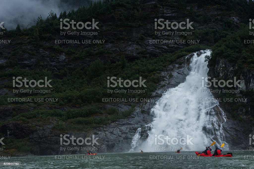 Paddling to giant Mendenhall waterfall stock photo