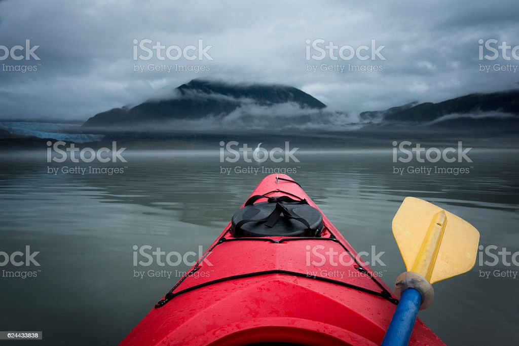 Paddling toward Mendenhall Glacier and waterfall stock photo