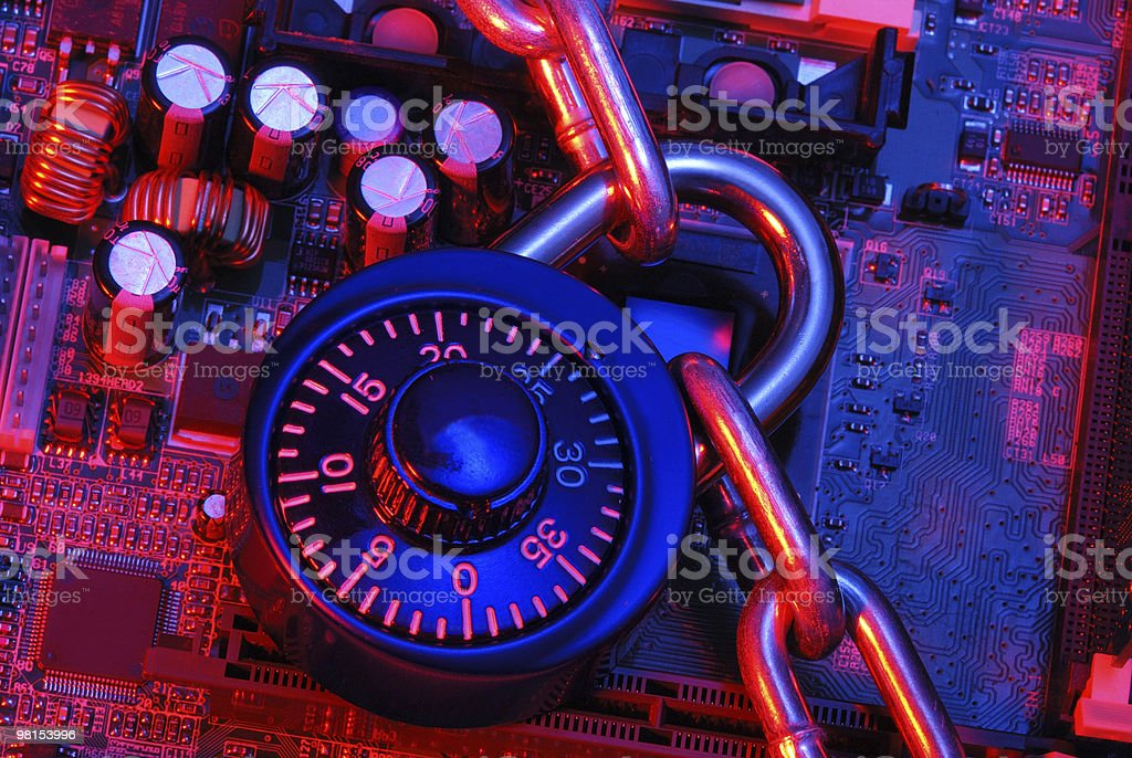 A padlock and chain of electronic security stock photo