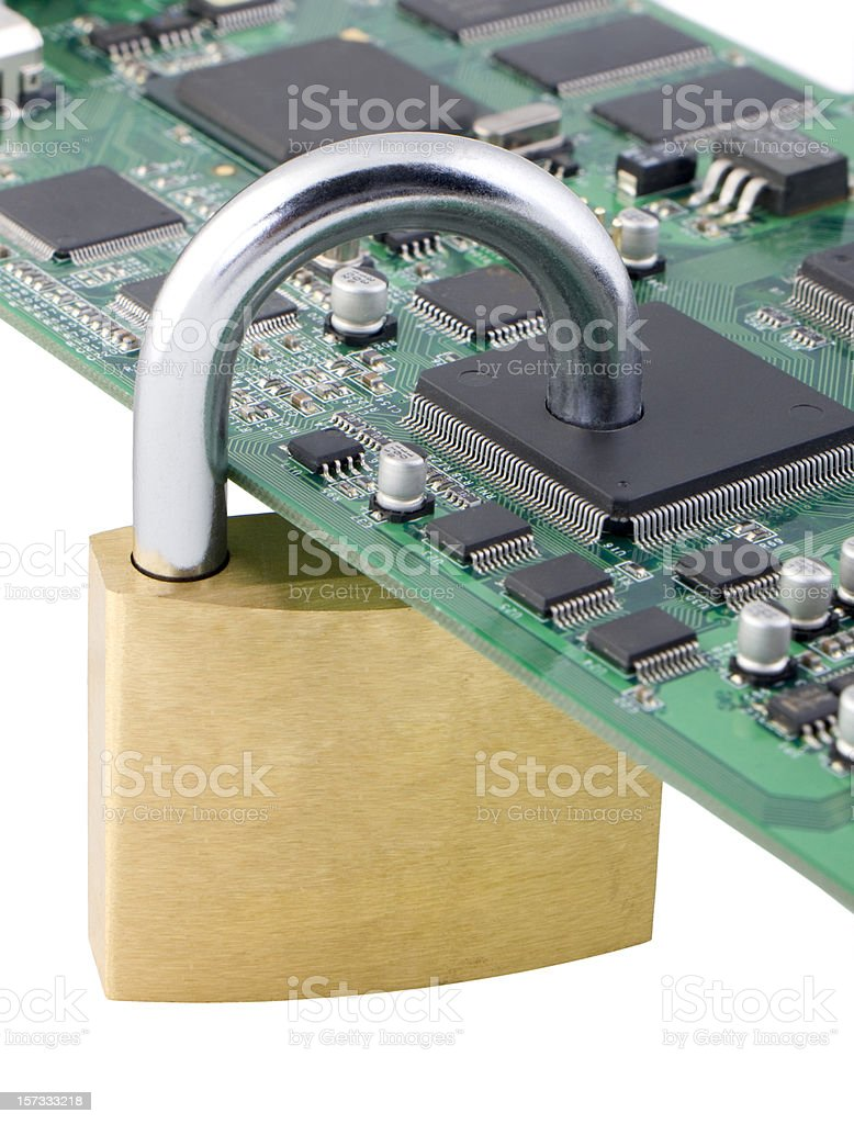 Padlock going through chip: security first! (series) royalty-free stock photo