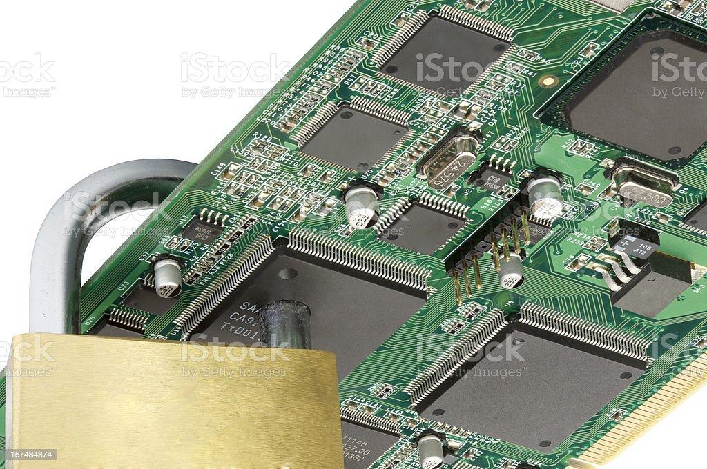 Padlock going through chip: security first! (series) stock photo