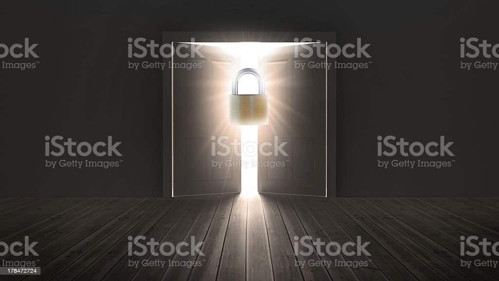 Padlock guarding door to bright light stock photo
